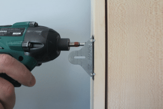 install a pre-hung door, attach it, step 2