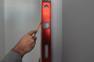 install a pre-hung door, mark it, step 1