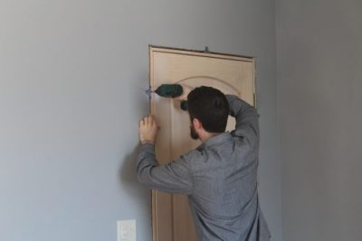 install a pre-hung door, hang it, step 3