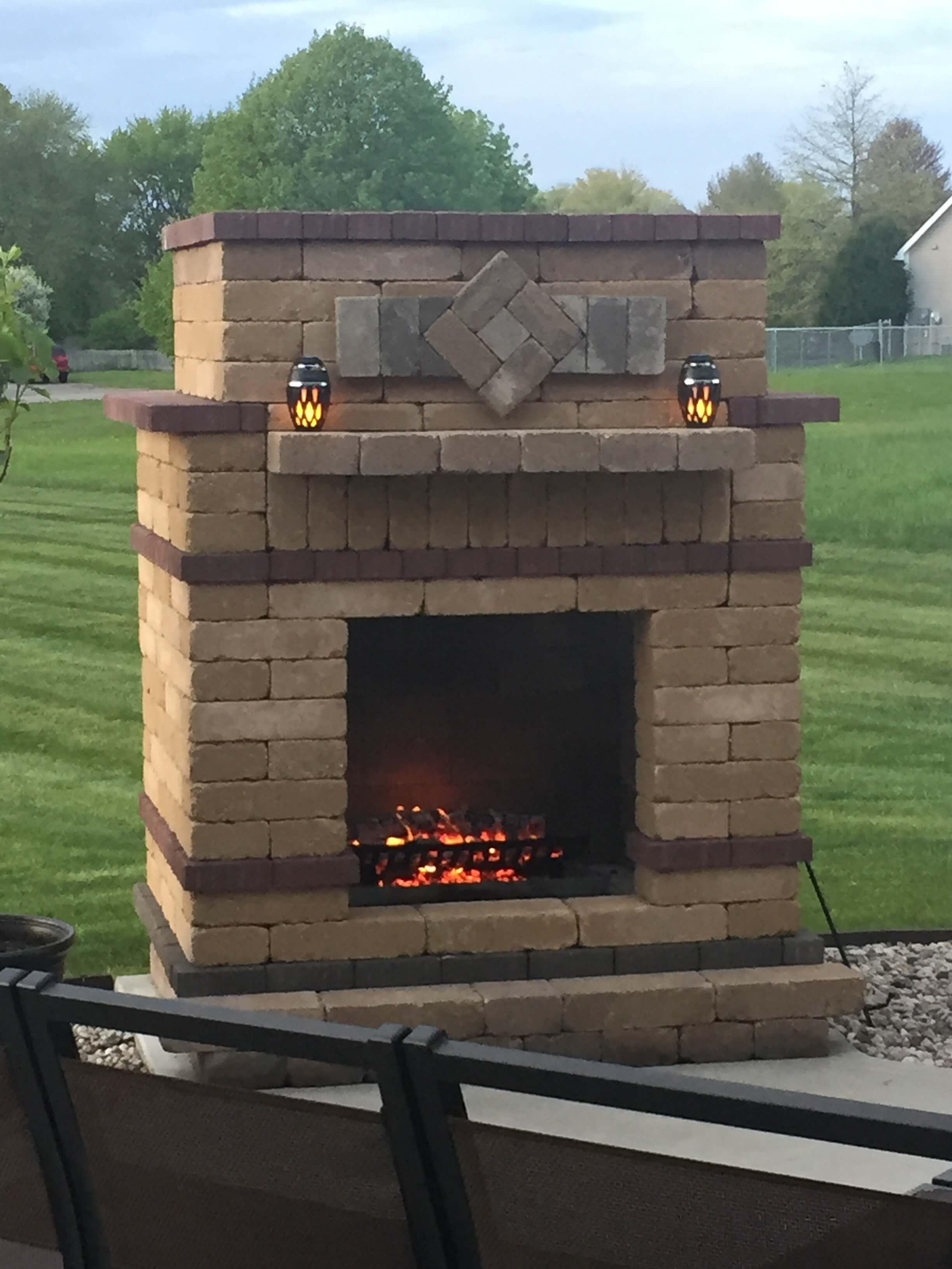Brick fireplace outdoors.