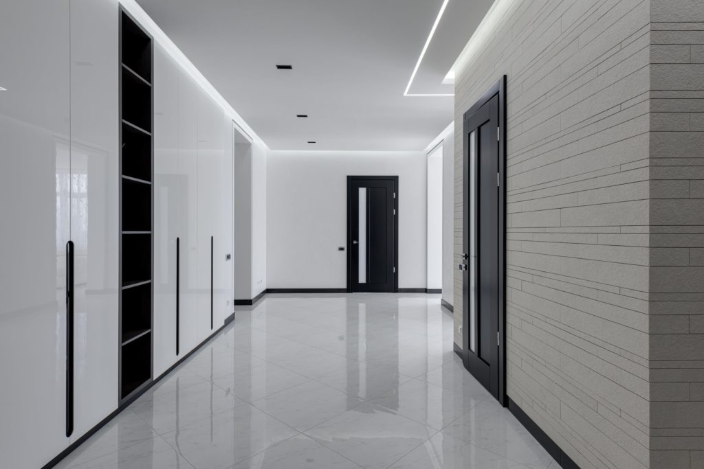 Black interior doors with white walls.