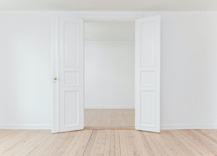 White door with white walls.