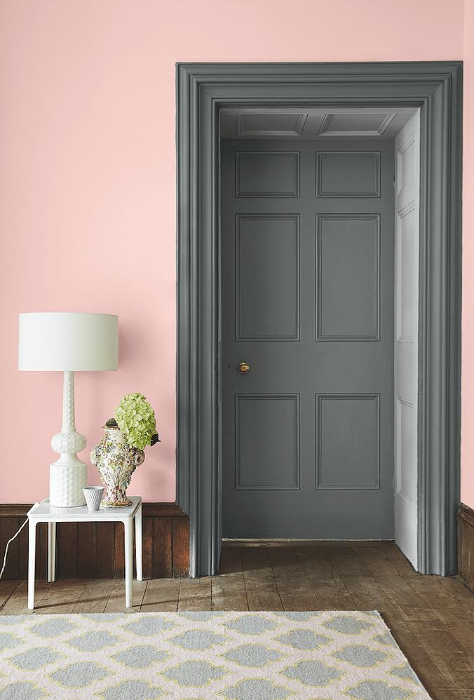 Grey door with soft pink walls.